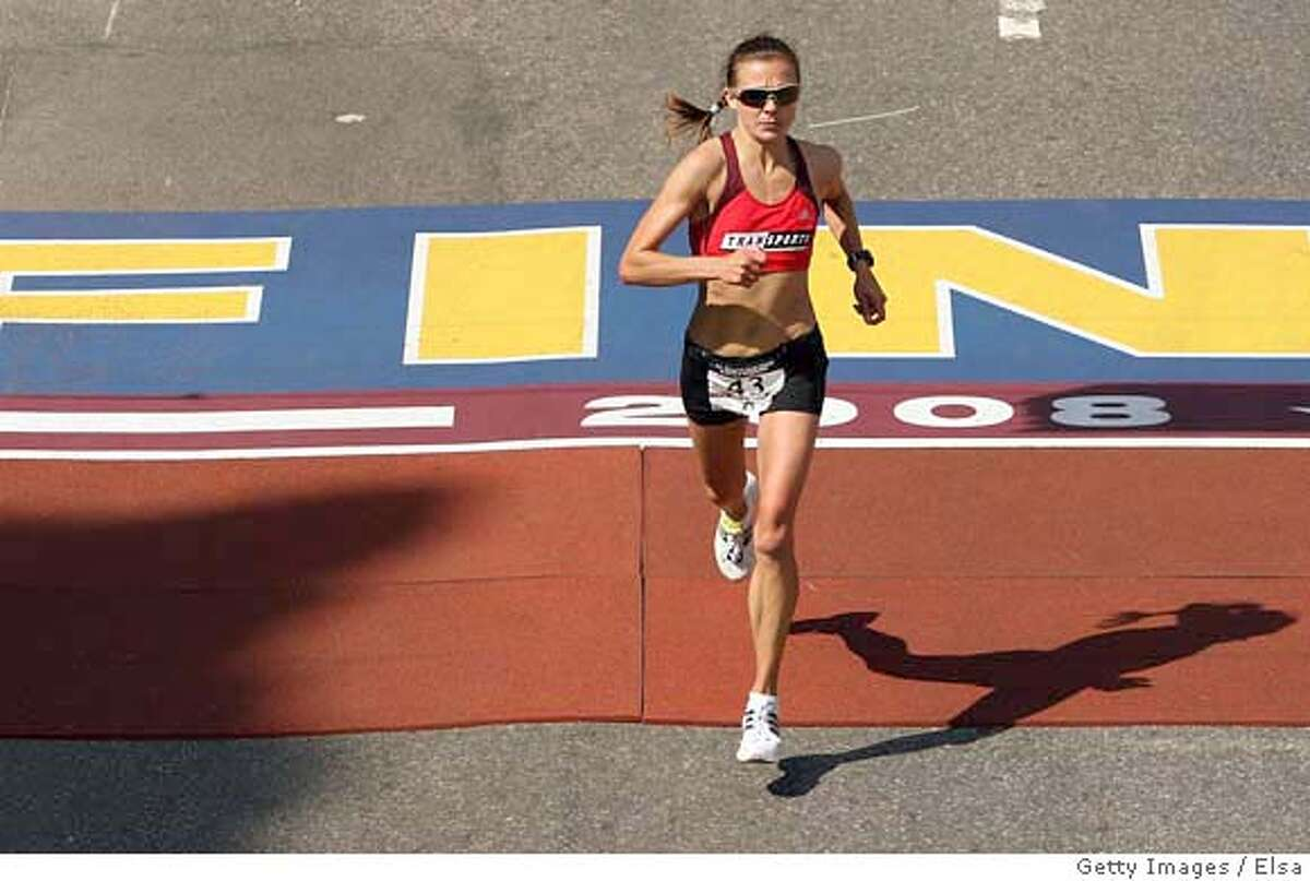 ###Live Caption:BOSTON - APRIL 20: Magdalena Lewy-Boulet crosses the finish line during the U.S. Women's Olympic Marathon Trials April 20,2008 in Boston, Massachusetts. Lewy-Boulet finished second. (Photo by Elsa/Getty Images)###Caption History:BOSTON - APRIL 20: Magdalena Lewy-Boulet crosses the finish line during the U.S. Women's Olympic Marathon Trials April 20,2008 in Boston, Massachusetts. Lewy-Boulet finished second. (Photo by Elsa/Getty Images)###Notes:Women's Marathon Olympic Trials###Special Instructions: