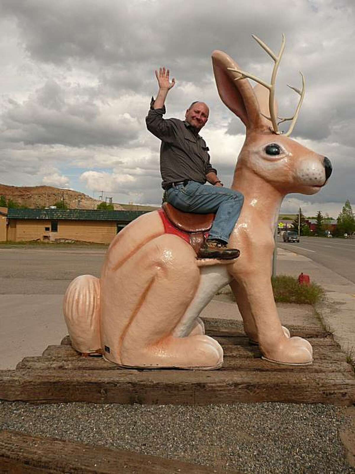 The author rides a statue of a Jackalope in Red Lodge, Montana. Scenes from John Flinn's 6,000-mile road trip through the great national parks of the west.