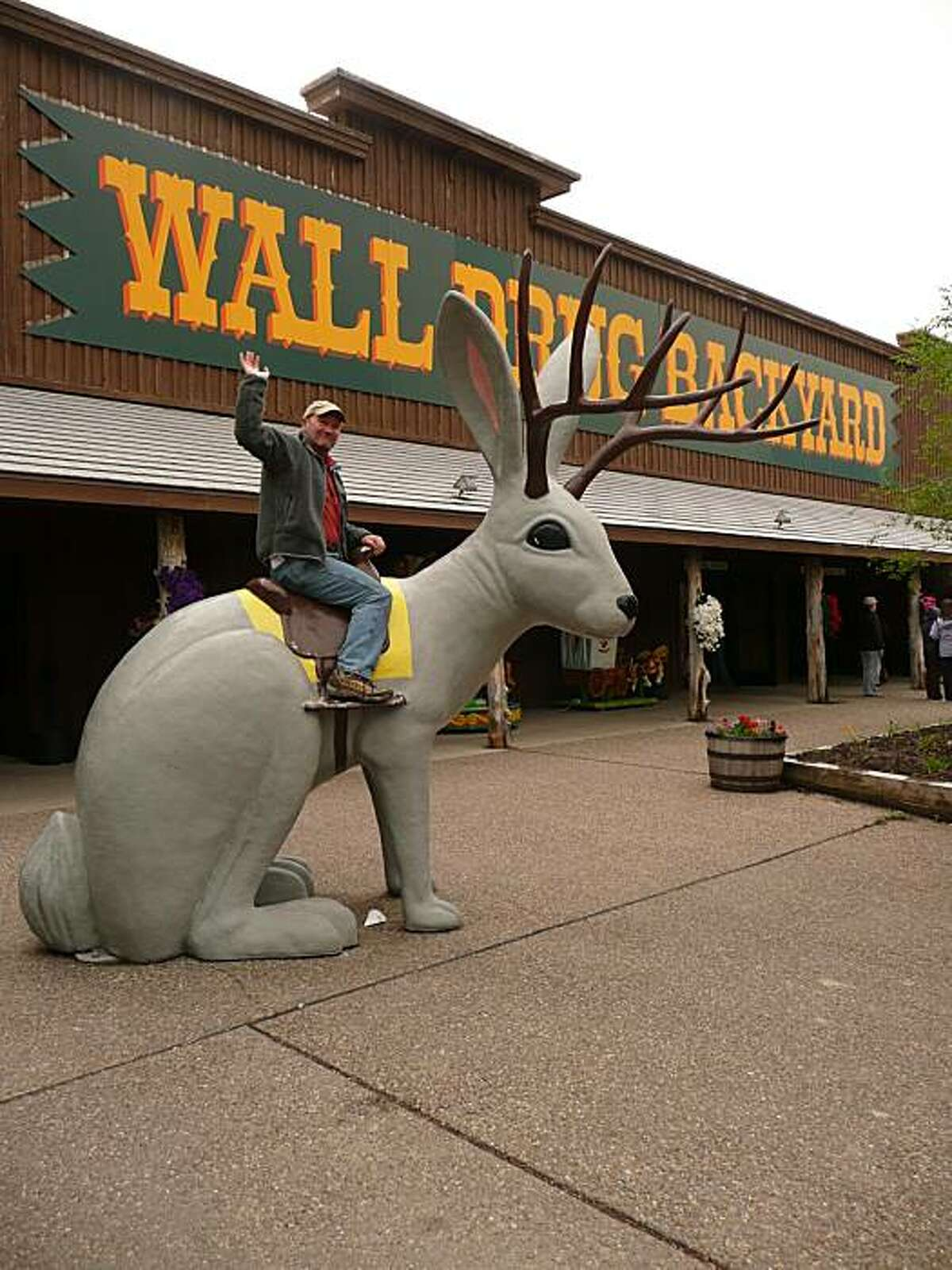 The author riding a statue of a Jackalope at Wall Drug, South Dakota, during a 6,000-mile road trip through the great national parks of the west.