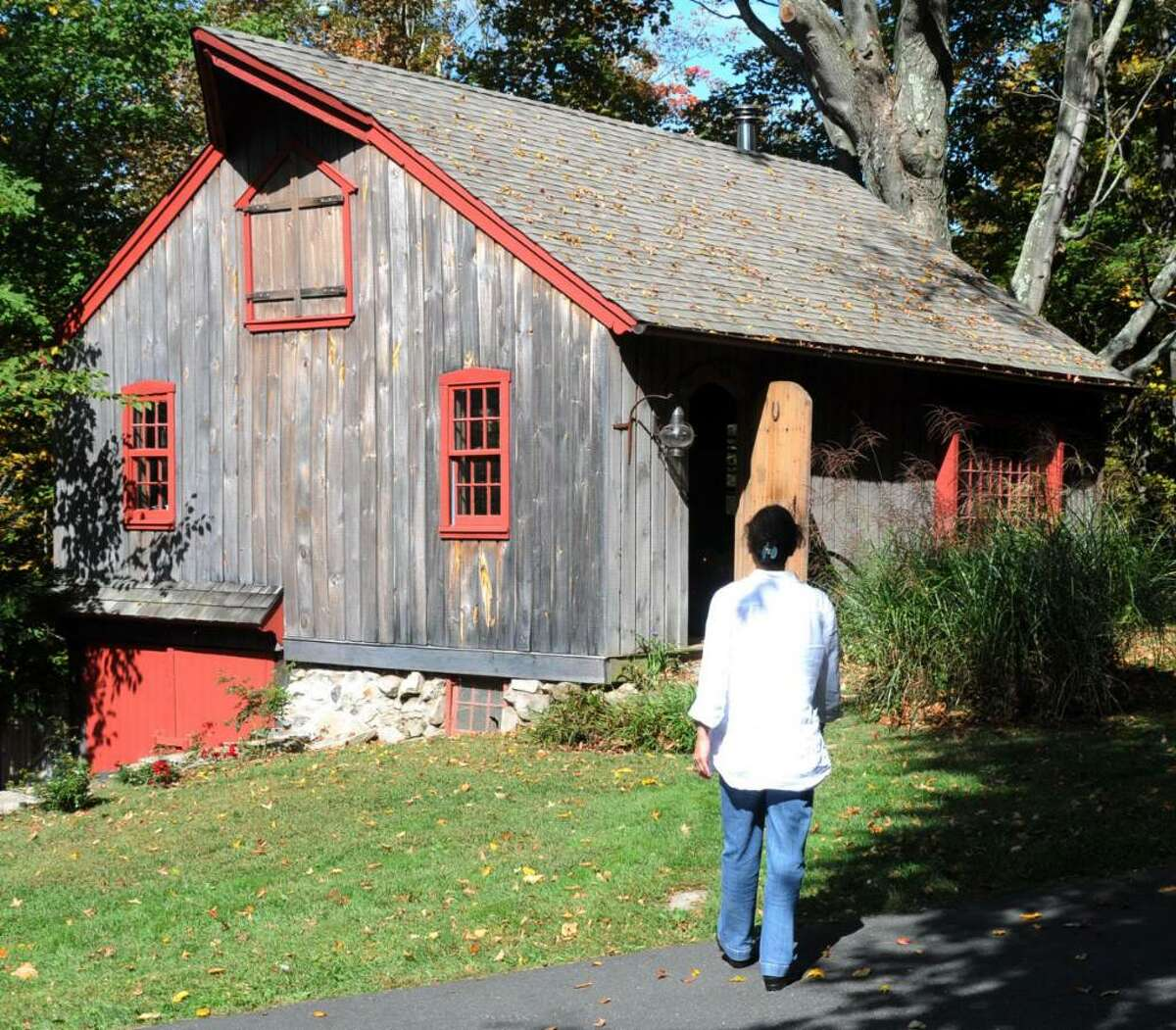 Owner and therapist, Lynn Carroll, of The Therapy Space in Sandy Hook, CT heads to her therapy studio just steps from her home, on Friday, Sept. 25, 2009. Carroll also has a therapy studio in Westport, CT.