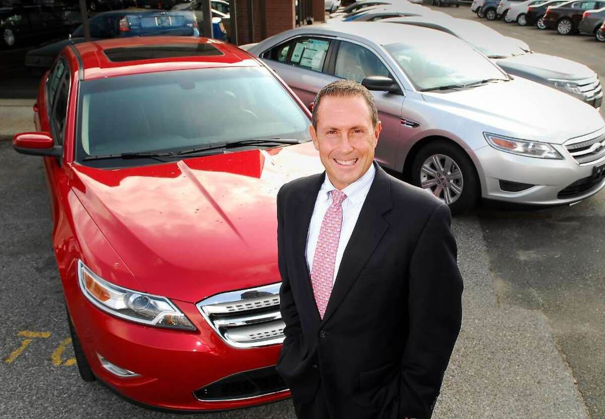 11-05-2009, STAMFORD FORD LINCOLN MERCURY DEALERSHIP, 212 MAGEE AVE., Dominic Franchella, Dealer Principal of the Stamford Ford Lincoln Mercury Dealership on Magee Ave in Stamford, poses on the lot of his dealership.