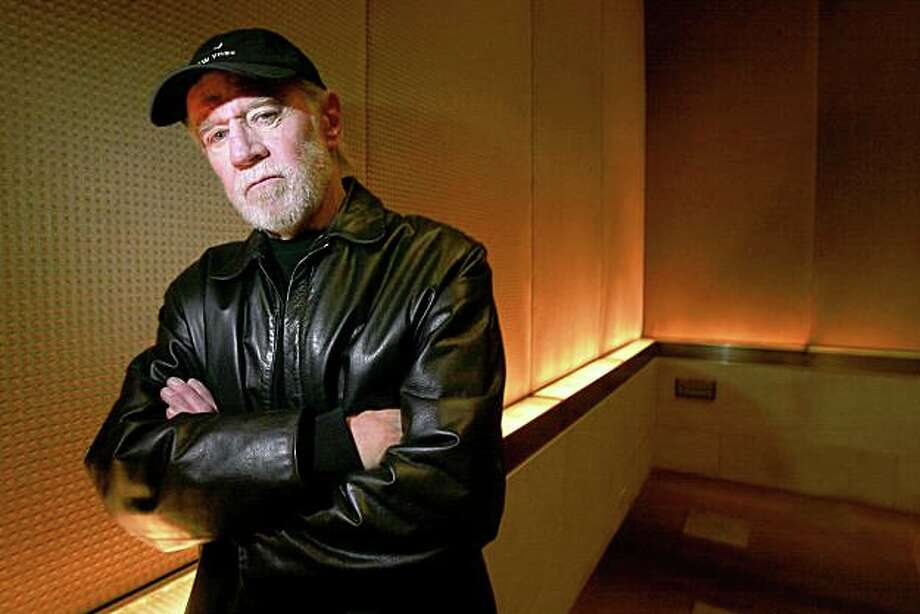 ** FILE ** This is a March 19, 2004 file photo of actor and comedian George Carlin posing in a New York hotel .  A publicist for George Carlin says the legendary comedian has died of heart failure at a hospital in Santa Monica, Calif., Sunday June 22, 2008.    (AP Photo/Gregory Bull/file) Photo: Gregory Bull, AP