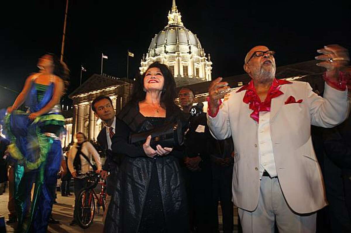 Jan Mirikitani (middle) and Rev. Cecil Williams (right) arrive in front of the Opera House, who is honoring his 45th year at Glide Church featuring Maya Angelou and musical groups in San Francisco, CA, on Thursday, November 12, 2009.