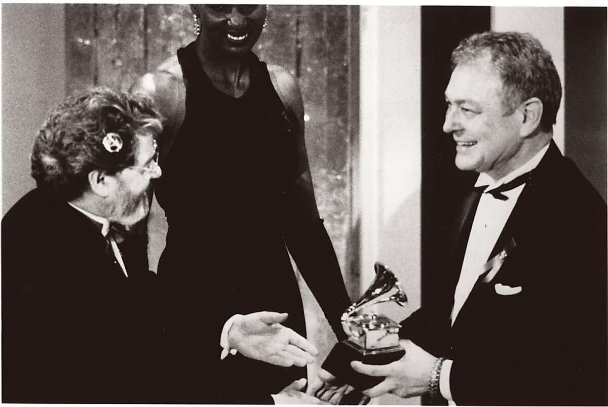 At ceremonies in Los Angeles in 1993, San Francisco Symphony Chorus Director Vance George accepts the Symphony's first-ever Grammy award. For their performance of Orff's 'Carmina burana,' they won 'Best Choral Recording.'