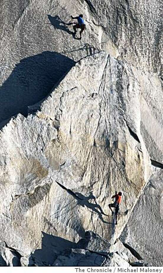 Speed climbers Yuji Hirayama, top, of Japan and Hans Florine, of Lafayette, Calif.,  work their way up the Texas Flake to set a  new record of climbing the Nose route of El Capitan in Yosemite National Park on July 2, 2008. Their time was  2 hours,  43 minutes and 33 seconds, beating the previous record of 2 hours and 45 minutes set by German brothers Thomas and Alexander Huber last October.Photo by Michael Maloney / The Chronicle Photo: Michael Maloney, The Chronicle