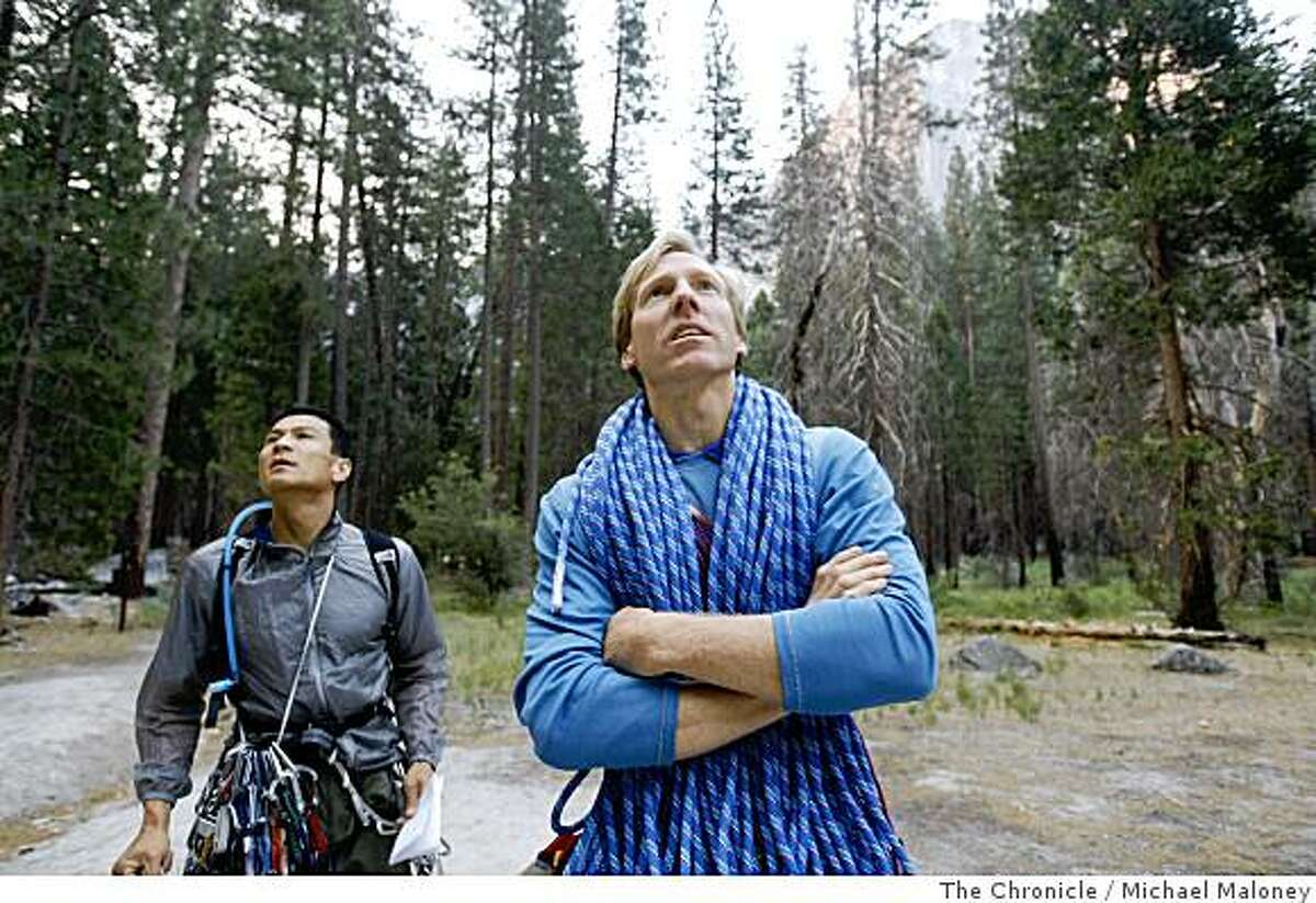 Speedclimbers Yugi Hirayama, of Japan, left, and Hans Florine of Lafayette, Calif., look up at Yosemite's El Capitan just prior to climbing it on June 23, 2008. This was just a practice climb. Later this week, they will attempt a new record of climbing the Nose route of El Capitan to beat the current record of 2 hours, 45 minutes and 45 seconds.Photo by Michael Maloney / The Chronicle