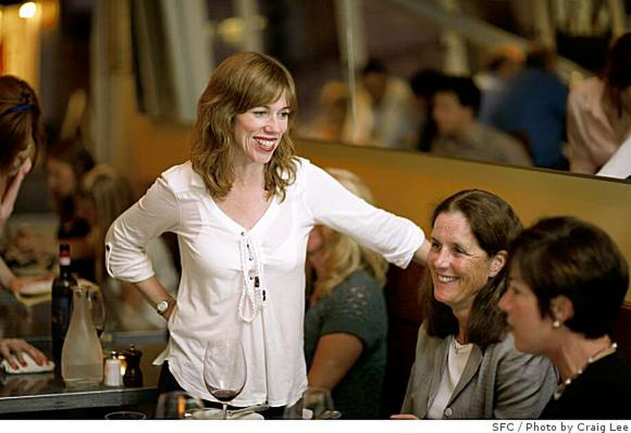 Anne Stoll, owner of Delfina restaurant, talking with Penny Oakley (middle) and Andrea Schatz (right) in San Francisco, Calif., on June 16, 2008Photo by Craig Lee / The Chronicle Photo: Photo By Craig Lee, SFC