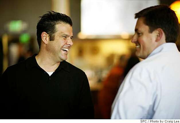 Richard Wood, owner of Wood Tavern restaurant, greeting friend, Michael Brown in Oakland, Calif., on June 16, 2008Photo by Craig Lee / The Chronicle Photo: Photo By Craig Lee, SFC