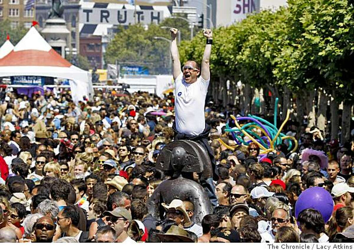 Crowds flock and cheer at the Civic Center as the music from the the Main Stage starts for the 38th Annual San Francisco LGBT Pride Celebration.Photo by Lacy Atkins /The Chronicle