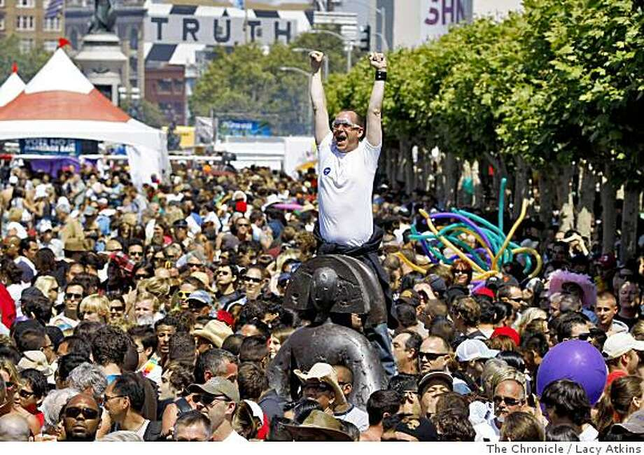 Crowds flock and cheer at the Civic Center as the music from the the Main Stage starts for the  38th Annual San Francisco LGBT Pride Celebration.Photo by Lacy Atkins /The Chronicle Photo: Lacy Atkins, The Chronicle