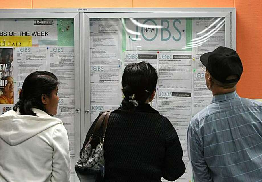 SAN FRANCISCO - NOVEMBER 06:  People look over job listings on display at the One Stop Career Link center November 6, 2009 in San Francisco, California. The national unemployment rate for October reached 10.2 percent, the highest level since 1983. An estimated 16 million Americans are out of work.  (Photo by Justin Sullivan/Getty Images) Photo: Justin Sullivan, Getty Images