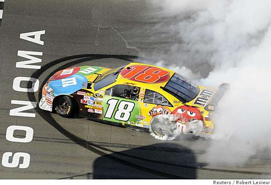 Kyle Busch Does Burnouts After Winning The NASCAR Sprint Cup Toyota/Save  Mart 350 At