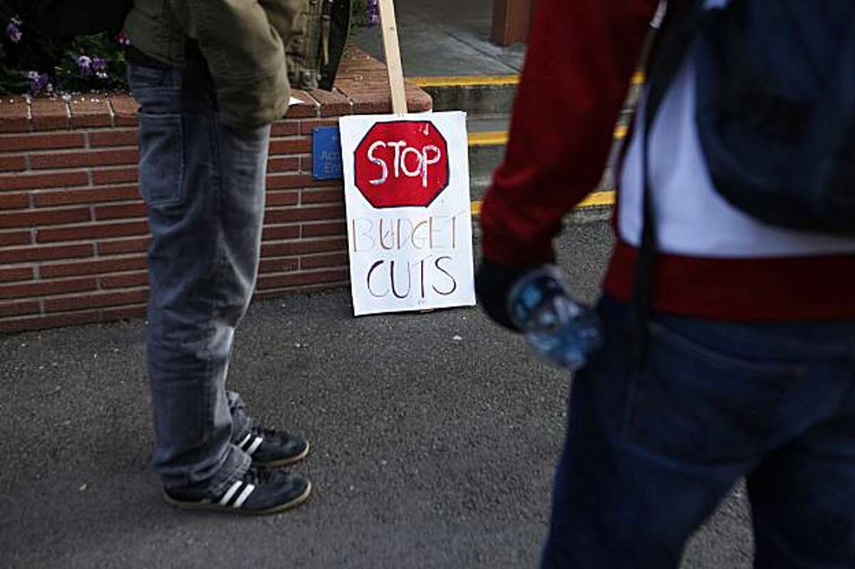 San Francisco State Students upset by budgets cuts to their school protest outside the SFSU business department on Wednesday.