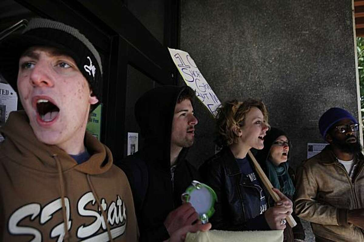 Daniel DeLorimier, Evan Stuart, Ivy Anderson, Dominique Piccinino and Lynn Gentry, all San Francisco State Students upset by budgets cuts to their school, protest outside the SFSU business department on Wednesday. The protesters blocked all entrances to the school and a few protesters have holed themselves off inside.