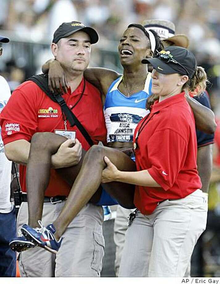 Alysia Johnson is carried off the track by officials after the women's 800 meter quarterfinal at the U.S. Olympic Track and Field Trials in Eugene, Ore., Friday, June 27, 2008. Photo: Eric Gay, AP