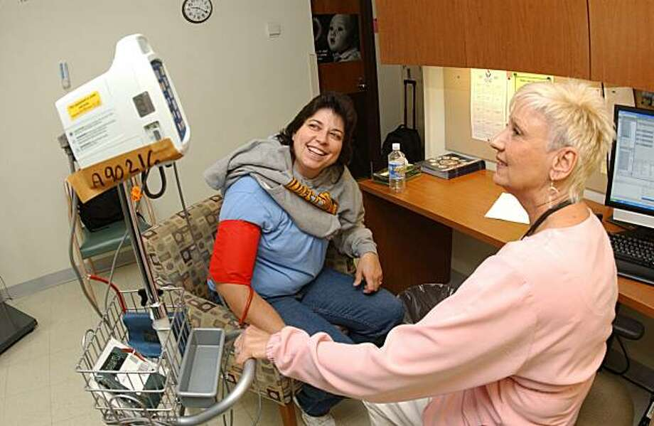"U.S. Army veteran Dee Myerly of Gerrardstown, W.Va., smiles while getting her blood pressure checked by Dolores ""Dolly"" Doherty, LPN, Friday, Nov. 13, 2009, at the Veterans Affairs  Medical Center's Treatment/Triage Room at the Well Women Clinic in Martinsburg, W.Va. (AP Photo/Ron Agnir) Photo: Ron Agnir, Associated Press"