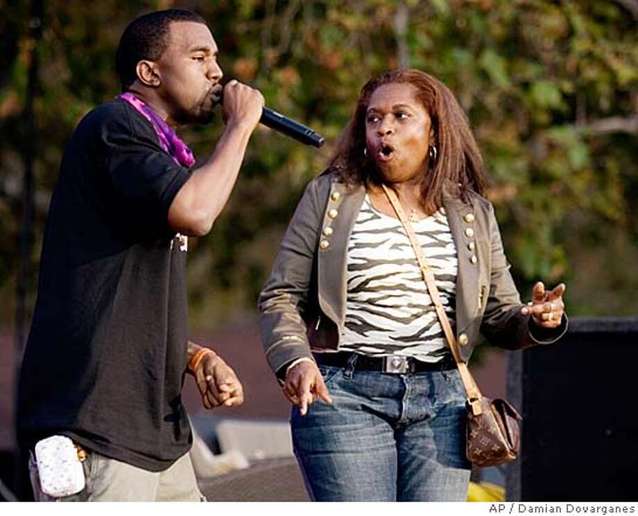 """**FILE**Singer Kanye West performs with his mother, Donda West, outdoors during a taping of """"The Ellen DeGeneres Show,"""" in this May, 2006 file photo, in Burbank, Calif. A spokesman for West said Donda West died Saturday night in Los Angeles. (AP Photo/Damian Dovarganes, file)  Ran on: 11-12-2007  Donda West appears with her son, Kanye West, on &quo;The Ellen DeGeneres Show&quo; in May 2006. She was chief executive of the rapper's business enterprises. A MAY 2006, FILE PHOTO Photo: Damian Dovarganes"""