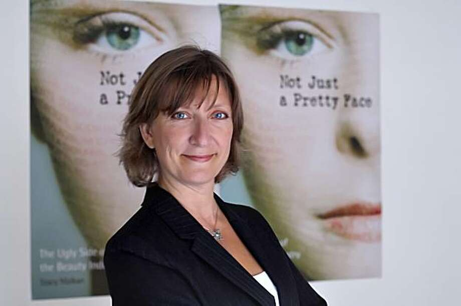 "Author Stacy Malkan in fron of her new book ""Not Just a Pretty Face"" Photo: Handout"