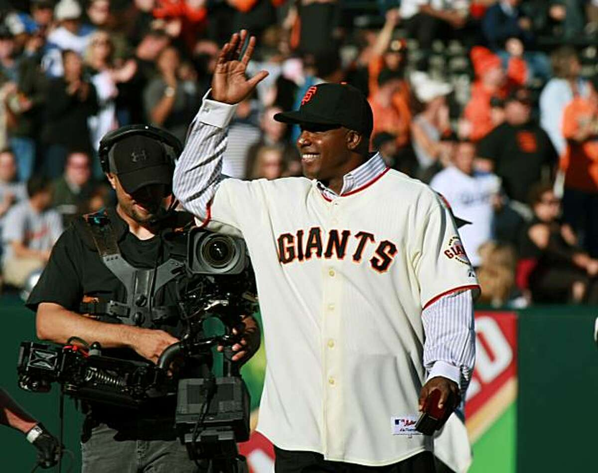 Former San Francisco Giants left fielder Barry Bonds greets the fans at AT&T Park during a pre-game ceremony honoring past Giant fielders prior to their baseball game with the Los Angeles Dodgers Saturday, Aug. 9, 2008, in San Francisco.