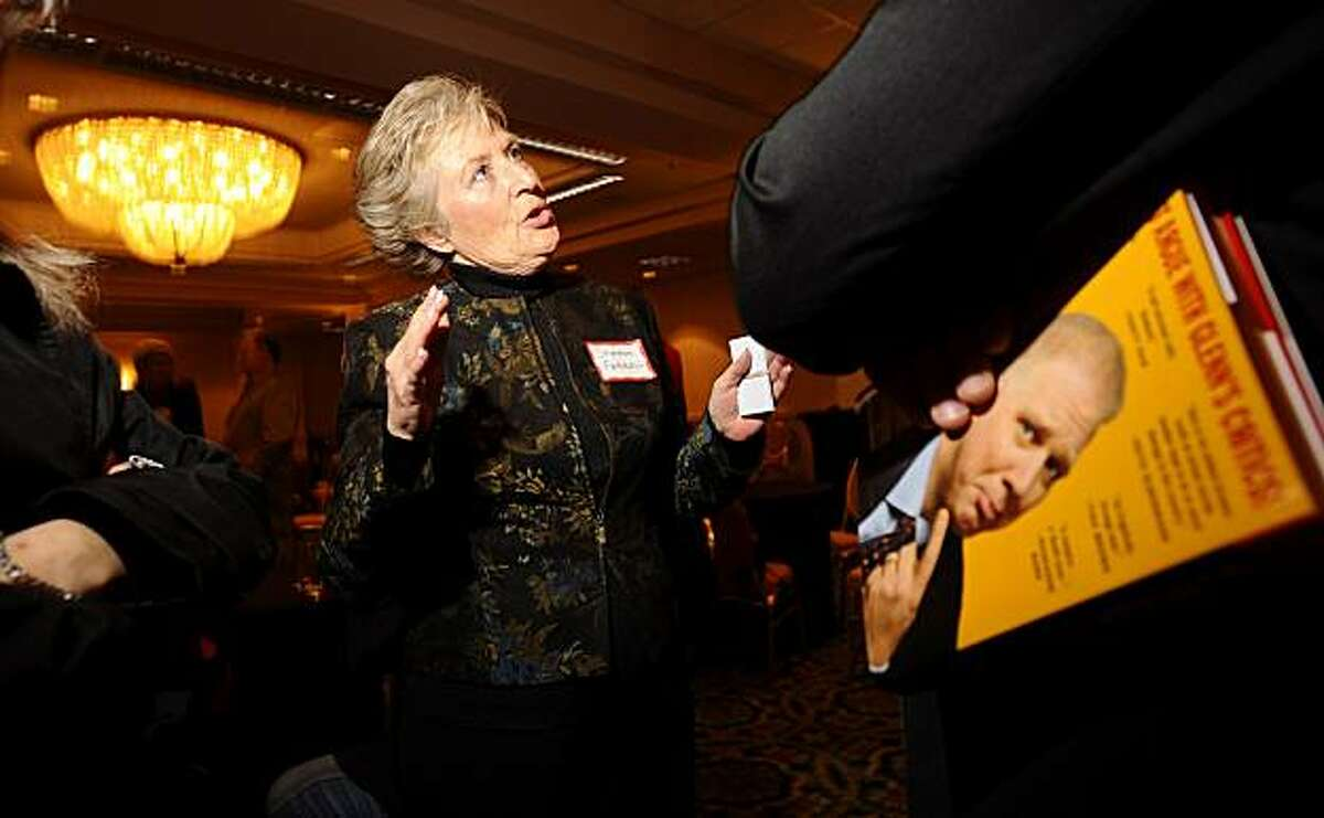 Sharon Ferrell, chair of the East Bay Freedom Fighters, speaks with a guest at the 1st Annual East Bay Conservative Christmas Party on Thursday, Dec. 10, 2009, in San Ramon, Calif. The guest is holding a copy of Glenn Beck's book which he won earlier during a raffle.