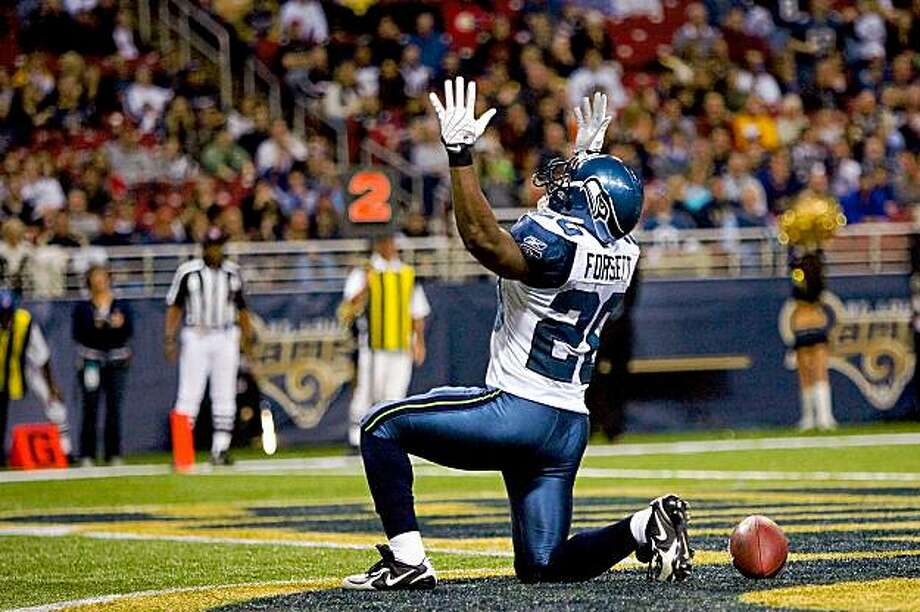 ST. LOUIS - NOVEMBER 29:  Justin Forsett #20 of the Seattle Seahawks celebrates a touchdown against the St. Louis Rams at the Edward Jones Dome on November 29, 2009 in St. Louis, Missouri.  The Seahawks beat the Rams 27-17.  (Photo by Dilip Vishwanat/Getty Images) Photo: Dilip Vishwanat, Getty Images