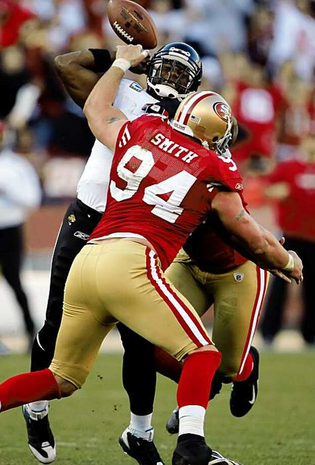 David Garrard is sacked in the third quarter by Manny Lawson, with Justin Smith recovering the ensuing fumble Sunday at Candlestick Park. Photo: Carlos Avila Gonzalez, The Chronicle