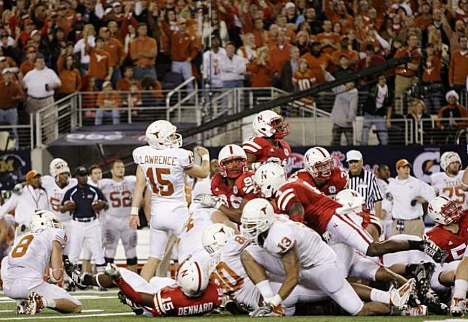 ARLINGTON, TX - DECEMBER 5: Hunter Lawrence #15 of the Texas Longhorns watches the ball after kicking the game-winning field goal to win the game 10-6 over the Nebraska Cornhuskers at Cowboys Stadium on December 5, 2009 in Arlington, Texas.  (Photo by Jamie Squire/Getty Images) Photo: Jamie Squire, Getty Images