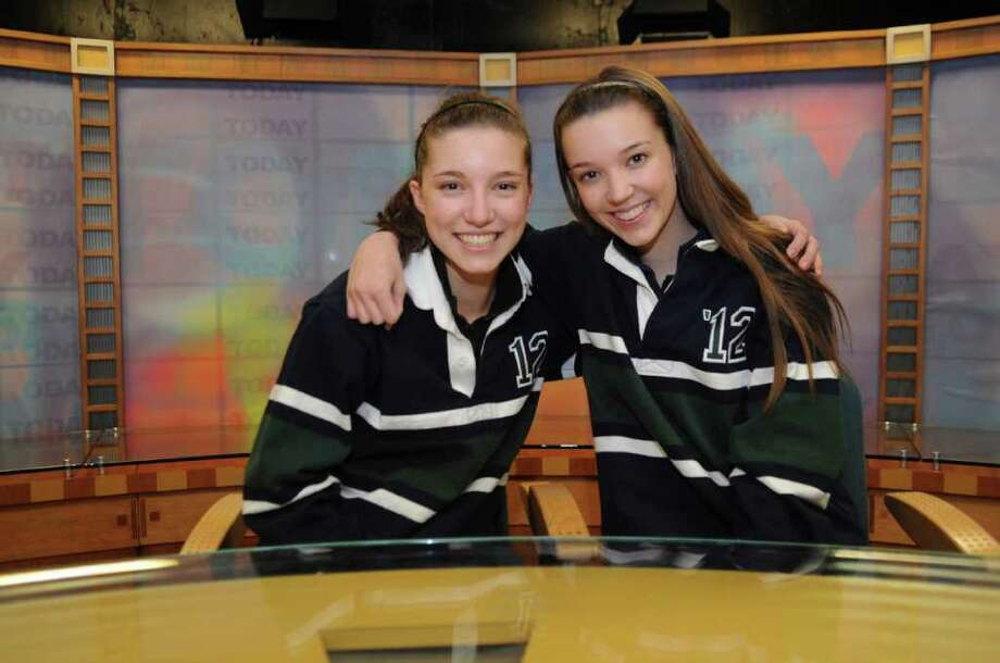 Christine, and Nicole Bloom, right seniors at Convent of the Sacred Heart, pose in the David Bloom broadcast studio Thursday, Feb.9, 2012. The sudio is named after Christine and Nicole's father, an NBC correspondent who died while covering the war in Iraq.  Bloom's colleague NBC Nightly News anchor Tom Brokaw, will be the speaker at the Convent of the Sacred Heart commencement in June. Photo: Helen Neafsey / Greenwich Time