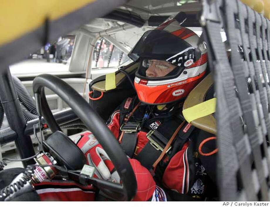 NASCAR driver Kyle Petty waits in his car to practice for the Autism Speaks 400 auto race at the Dover International Speedway in Dover, Del., Saturday, June 2, 2007.(AP Photo/Carolyn Kaster) Photo: Carolyn Kaster