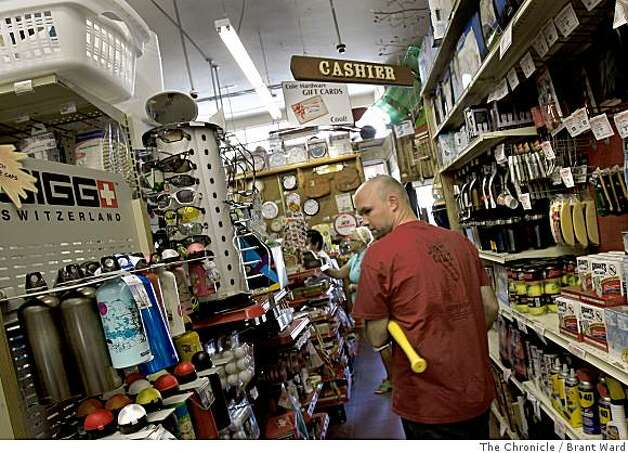At Cole Hardware, Brian Larkins picks up a whiffle bat and balls for an upcoming trip pointing to the wide variety of merchandise this hardware store carries. Cole Street in San Francisco features a wide variety of independent businesses, restaurants, coffee and retail stores in a relaxed, family oriented community Wednesday June 11, 2008.   By Brant Ward / The Chronicle Photo: Brant Ward, The Chronicle