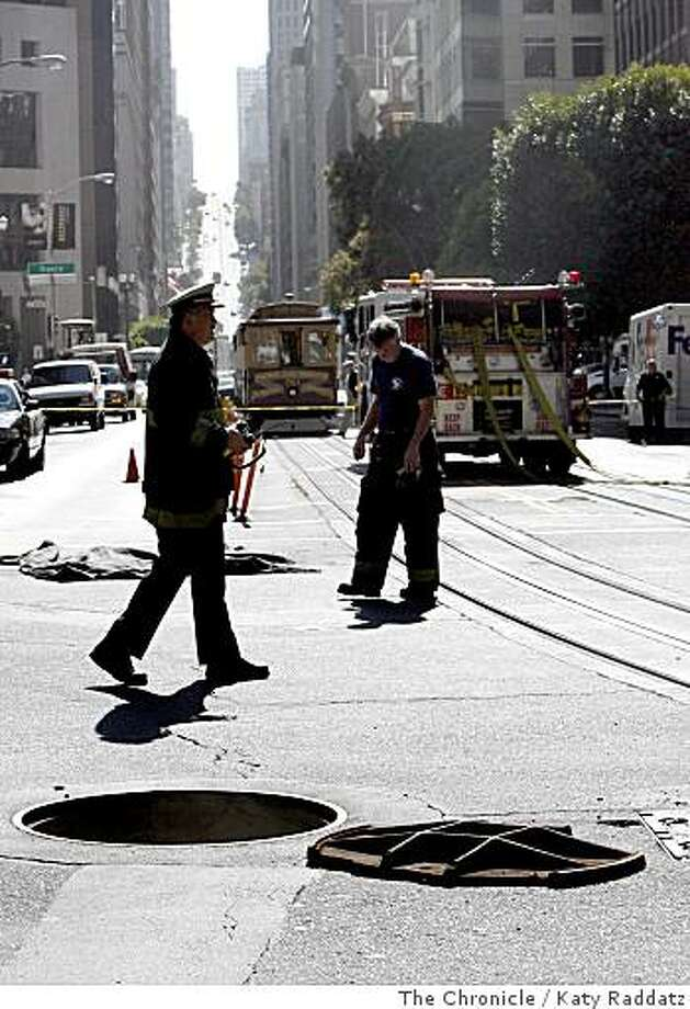 A manhole cover lies upside down next to the manhole it was covering after an explosion threw two manhole covers into the air at the corner of Drumm and California Streets, in San Francisco, Calif.  on Tuesday,  June 24, 2008.Photo by Katy Raddatz / The Chronicle Photo: Katy Raddatz, The Chronicle