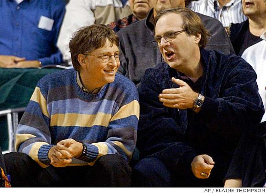 Bill Gates and Paul Allen attend a Portland Trail Blazers game. Allen owns the Trail Blazers. Photo: ELAINE THOMPSON, AP