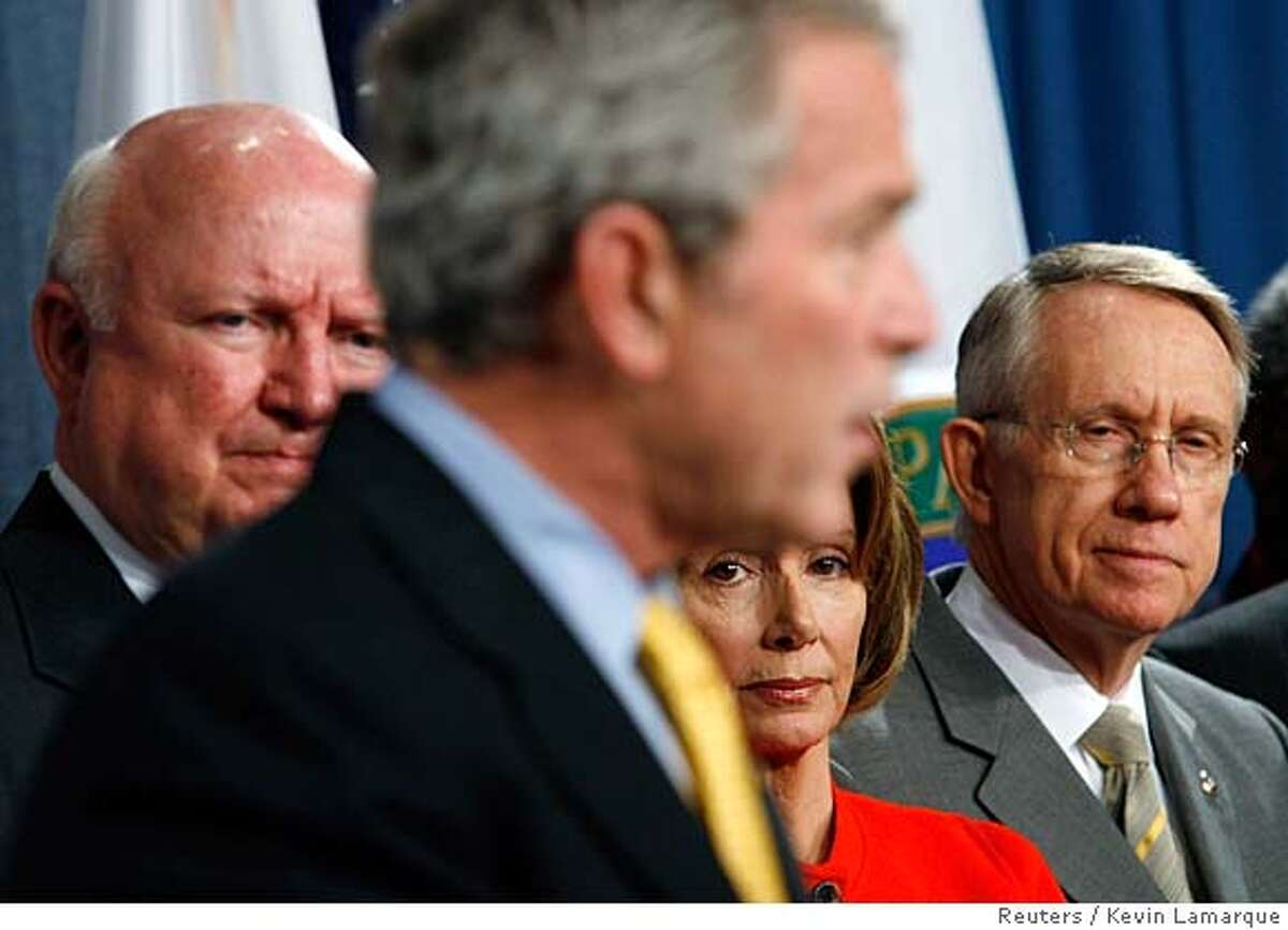 ###Live Caption:.S. President George W. Bush speaks during a signing ceremony for the Energy Independence and Security Act of 2007 at the U.S. Department of Energy in Washington, December 19, 2007. Listening to Bush (L-R) is Energy Secretary Sam Bodman, Speaker of the House Nancy Pelosi (D-CA) and Senate Majority Leader Harry Reid (D-NV). REUTERS/Kevin Lamarque (UNITED STATES) Ran on: 12-20-2007###Caption History:U.S. President George W. Bush speaks during a signing ceremony for the Energy Independence and Security Act of 2007 at the U.S. Department of Energy in Washington, December 19, 2007. Listening to Bush (L-R) is Energy Secretary Sam Bodman, Speaker of the House Nancy Pelosi (D-CA) and Senate Majority Leader Harry Reid (D-NV). REUTERS/Kevin Lamarque (UNITED STATES) Ran on: 12-20-2007 President Bush (center) speaks in Washington at a signing cere- money for the law raising fuel-economy standards. Listening to him are (from left) Energy Secretary Sam Bodman, House Speaker Nancy Pelosi and Senate Majority Leader Harry Reid. Ran on: 12-20-2007 President Bush (center) speaks in Washington at a signing cere- money for the law raising fuel-economy standards. Listening to him are (from left) Energy Secretary Sam Bodman, House Speaker Nancy Pelosi and Senate Majority Leader Harry Reid.###Notes:###Special Instructions:U.S. President George W. Bush speaks during a signing ceremony for the Energy Independence and Security Act of 2007 at the U.S. Department of Energy in Washington, December 19, 2007. Listening to Bush (L-R) is Energy Secretary Sam Bodman, Speaker of the H