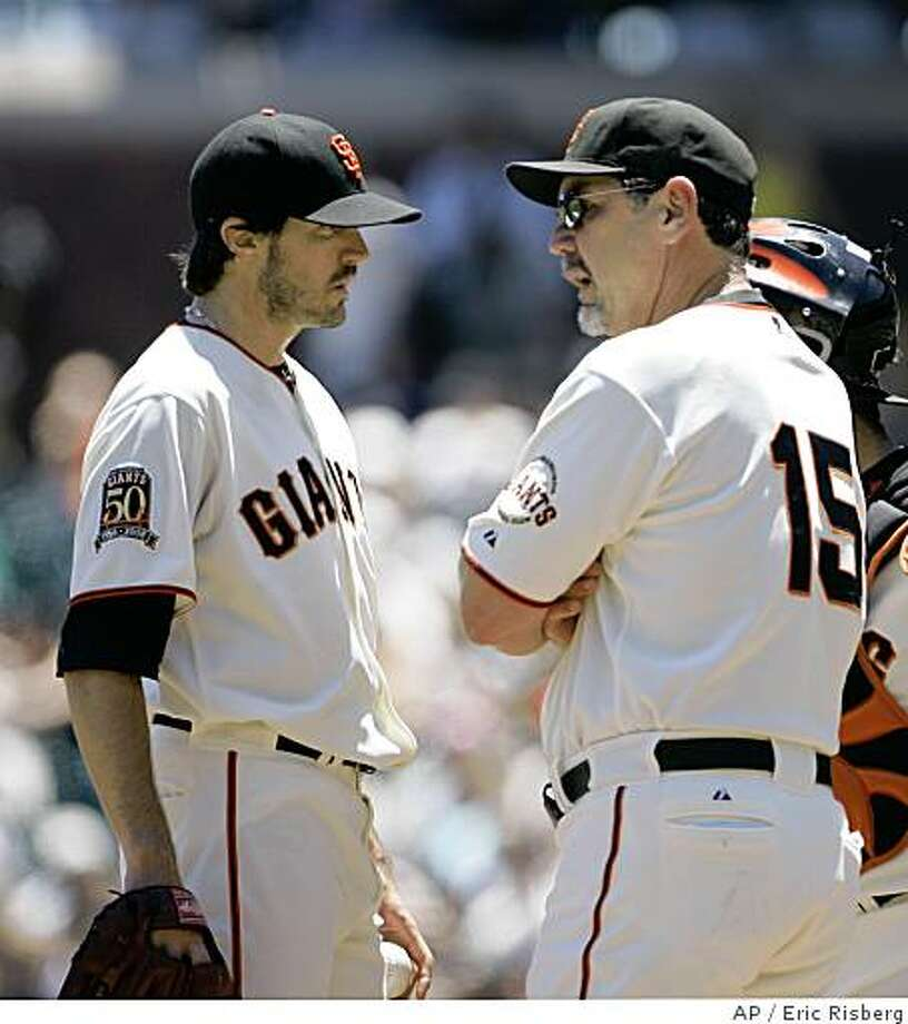 San Francisco Giants manager Bruce Bochy, right, talks with starting pitcher Barry Zito on the mound during the second inning of their baseball game against the Detroit Tigers in San Francisco, Wednesday, June 18, 2008. Zito gave up five runs and pitched two innings.  Detroit won the game 7-2. (AP Photo/Eric Risberg) Photo: Eric Risberg, AP