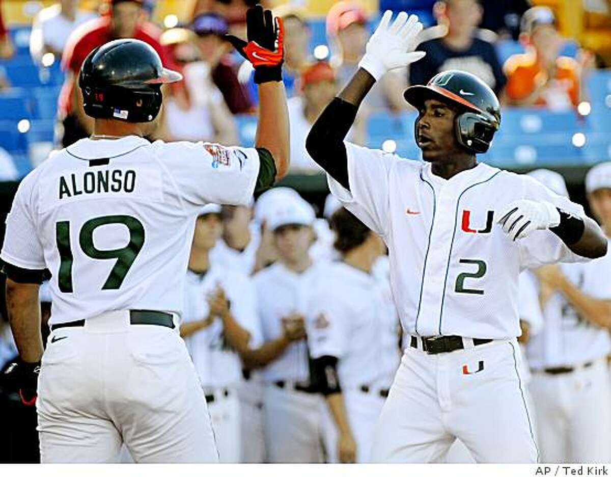 Miami's Jemile Weeks (2) is greeted by teammate Yonder Alonso after Weeks hit a home run in the first inning against Georgia in an NCAA College World Series baseball game, in Omaha, Neb., Saturday, June 14, 2008. (AP Photo/Ted Kirk)