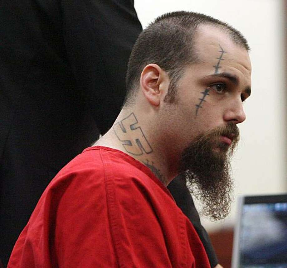 In this Dec. 4, 2009 photo, John Allen Ditullio Jr. sits in court in New Port Richey, Fla. Circuit Judge Michael Andrews said he would allow a licensed cosmetologist to be brought in an hour before each day's proceedings to cover up tattoos that Ditullio has acquired since his arrest in connection with the March 23, 2006 stabbing of 17-year-old Kristopher King. Ditullio faces charges of first-degree murder and attempted murder. (AP Photo/St. Petersburg Times, Brendan Fitterer) Photo: Fitterer, Brendan, AP