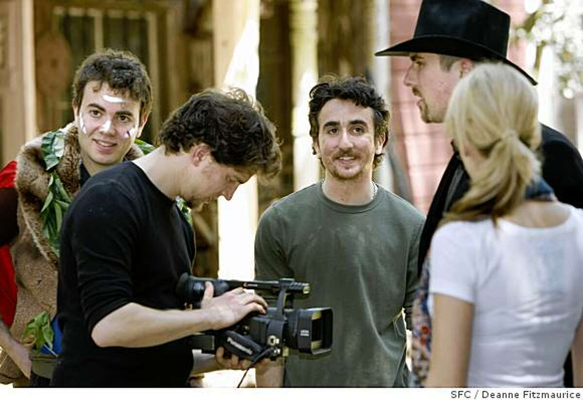 Vlad Baranovsky, left, and his brother Yuri, 2nd from left, work with cameraman, Dashiell Reinhardt and Justin Reinhardt, wearing hat. Creators of