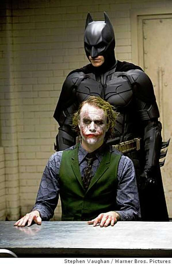 "Heath Ledger as the Joker and Christian Bale as Batman in ""The Dark Knight"" 2008HEATH LEDGER as The Joker and CHRISTIAN BALE as Batman in Warner Bros. Pictures� and Legendary Pictures� action drama �The Dark Knight.�  TM & � DC Comics.PHOTOGRAPHS TO BE USED SOLELY FOR ADVERTISING, PROMOTION, PUBLICITY OR REVIEWS OF THIS SPECIFIC MOTION PICTURE AND TO REMAIN THE PROPERTY OF THE STUDIO. NOT FOR SALE OR REDISTRIBUTION. ALL RIGHTS RESERVED. Photo: Stephen Vaughan, Warner Bros. Pictures"