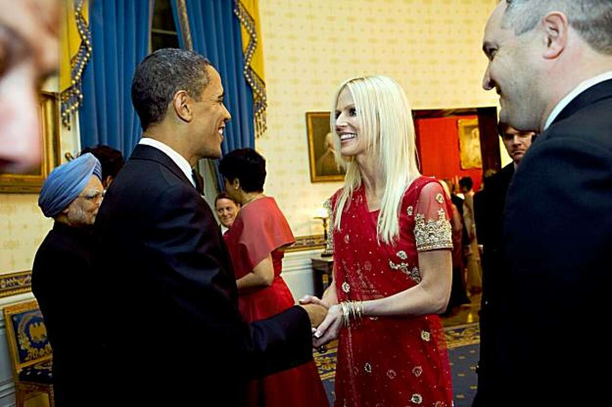 """This White House offical photo released November 27, 2009 shows President Barack Obama greets Michaele and Tareq Salahi during a receiving line in the Blue Room of the White House before the State Dinner with Prime Minister Manmohan Singh (L) of India, November 24, 2009. The two aspiring reality TV stars who gatecrashed a state dinner this week met President Barack Obama at the event, a White House photograph released on Friday showed. The Secret Service meanwhile issued an unusual mea culpa for the security lapse, with the director saying the agency was """"embarrassed"""" by the incident. AFP PHOTO/WHITE HOUSE PHOTO/ Samantha APPLETON == FOR EDITORIAL USE ONLY == (Photo credit should read Samantha Appleton/AFP/Getty Images)"""