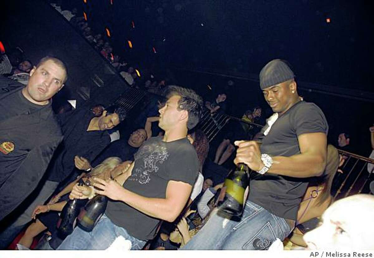 This photo released by DailyFiasco.com. shows Oakland Raiders wide receiver Javon Walker, right, at the Hard Rock Hotel and Casino in Las Vegas early Monday morning June 16, 2008. Walker could be released from the hospital Tuesday, June 17, 2008, a day after he was beaten, robbed and left unconscious on a Las Vegas street after a night of partying, police said. (AP Photo/DailyFiasco.com, Melissa Reese) **NO SALES**