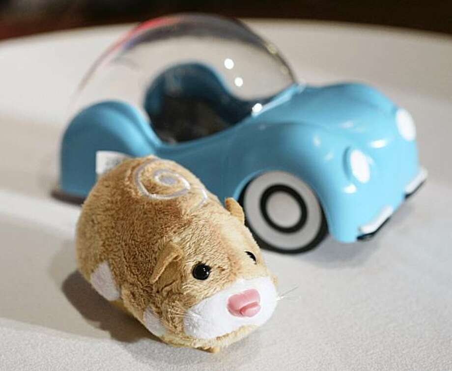 FILE - In this Oct. 1, 2009 file photo, a hamster from Zhu Zhu Pets, by Cepia, is shown at the Time to Play Holiday 2009 Most Wanted List event in New York. Zhu Zhu Pets, which retail for $8, are this year's bona fide must-have toy, following in the footsteps of past crazes for Tickle Me Elmo and Cabbage Patch Kids. (AP Photo/Mark Lennihan, file) Photo: Mark Lennihan, AP