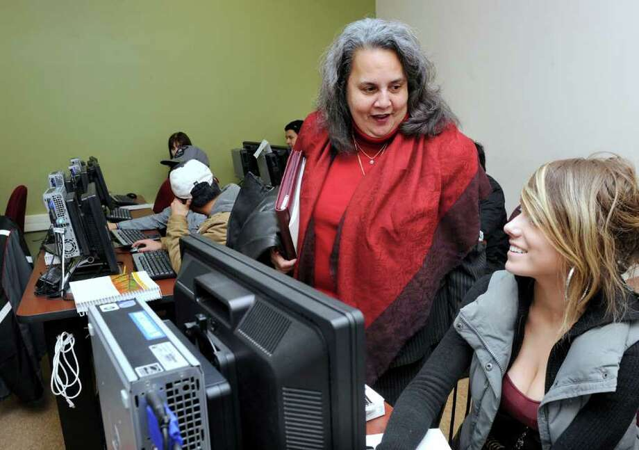 Daisy Coco De Filippis , president of Naugatuck Valley Community College, visits an introduction to computers class at the school's downtown Danbury facility Thursday. At right is Michaela Smith of Sherman. Photo taken Thursday, Feb. 9, 2012. Photo: Carol Kaliff / The News-Times