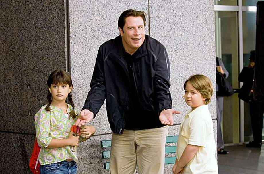 """In this film publicity image released by Disney, from left,  Ella Bleu Travolta, John Travolta, and Conner Rayburn are shown in a scene from the film, """"Old Dogs."""" Photo: Ron Phillips, AP"""
