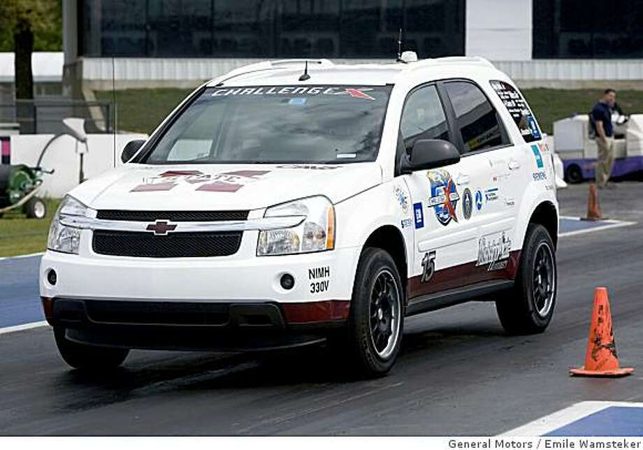 Mississippi State University's hybrid vehicle competes during the acceleration portion of the Challenge X competition in Englishtown, New Jersey, Thursday, May 15, 2008. The four-year Challenge X competition series challenges teams of students from 17 top North American universities to re-engineer a stock Chevrolet Equinox to achieve better fuel economy and lower greenhouse gas emissions ? without sacrificing its performance, utility and safety. Mississippi State University's hybrid vehicle competes during the acceleration portion of the Challenge X competition in Englishtown, New Jersey, Thursday, May 15, 2008. The four-year Challenge X competition series challenges teams of students from 17 top North American universities to re-engineer a stock Chevrolet Equinox to achieve better fuel economy and lower greenhouse gas emissions � without sacrificing its performance, utility and safety. (Photo by Emile Wamsteker for General Motors) Photo: Emile Wamsteker, General Motors