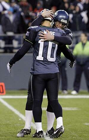 Seattle Seahawks' Jon Ryan, right, wraps up kicker Olindo Mare (10) in a hug after Mare scored on a 30-yard field goal  against the San Francisco 49ers in the fourth quarter during an NFL football game, Sunday, Dec. 6, 2009, in Seattle. The Seahawks won 20-17. (AP Photo/Elaine Thompson) Photo: Elaine Thompson, AP
