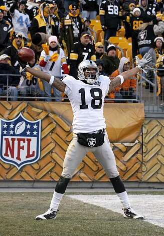 PITTSBURGH - DECEMBER 06:  Louis Murphy #18 of the Oakland Raiders celebrates a fourth quarter touchdown while playing the Pittsburgh Steelers on December 6, 2009 at Heinz Field in Pittsburgh, Pennsylvania. Oakland won the game 27-24.  (Photo by Gregory Shamus/Getty Images) Photo: Gregory Shamus, Getty Images
