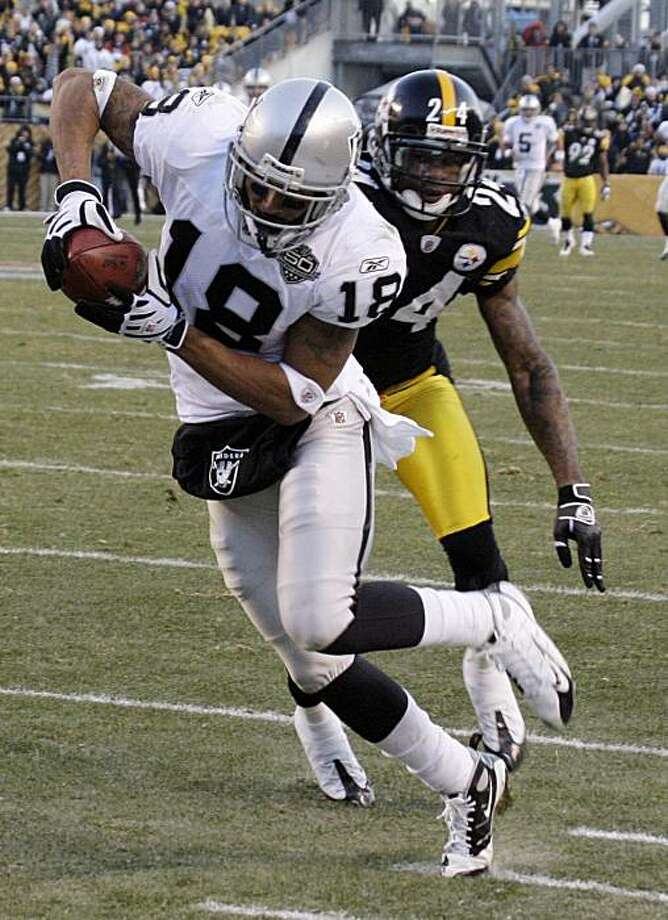 Oakland Raiders receiver Louis Murphy (18) gets past Pittsburgh Steelers cornerback Ike Taylor (24) and into the endzone for a fourth-quarter touchdown during an  NFL football game in Pittsburgh, Sunday, Dec. 6, 2009. The Raiders won 27-24. (AP Photo/Gene J. Puskar) Photo: Gene J. Puskar, AP