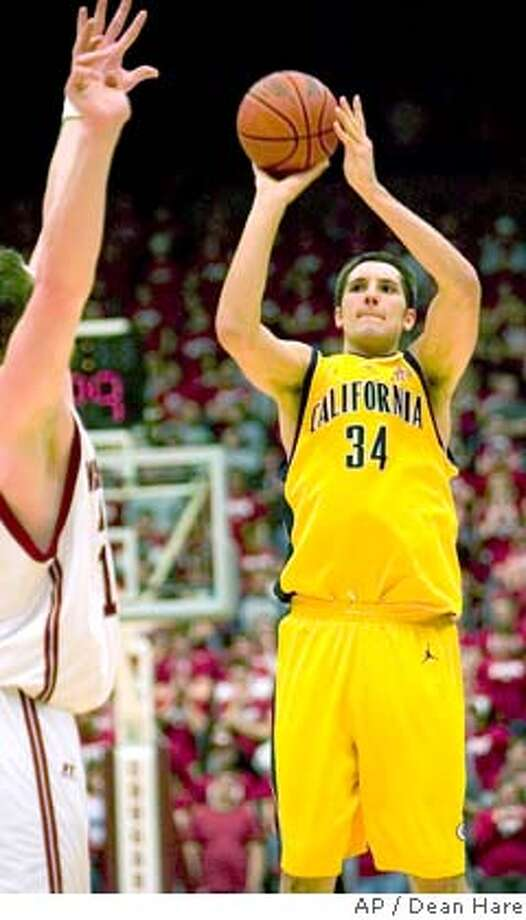 California forward Ryan Anderson (34) hits a three-point shot over the defense of Washington State center Aron Baynes during the first half of a college basketball game Thursday, Jan. 31, 2008, at Beasley Coliseum in Pullman, Wash. (AP Photo/Dean Hare)  Ran on: 02-01-2008  Cal's Ryan Anderson is good on this three-point shot in the first half of the Bears' win at Washington State.  Ran on: 02-01-2008  An emotional Jamal Boykin (right) gets a hug from Ryan Anderson after the Bears upset the No. 9 Cougars in Pullman. Photo: Dean Hare