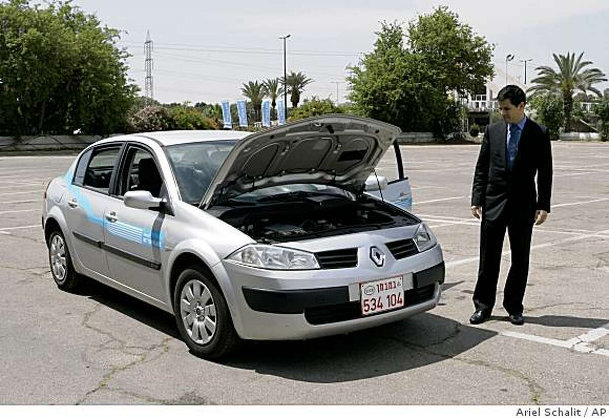 Shai Agassi, an Israeli-American entrepreneur displays a prototype of his electric car in Tel Aviv, Israel, Sunday, May 11, 2008. A Silicon Valley start-up company presented Sunday a prototype of the electric car it says will revolutionize transportation in Israel beginning in two years' time. (AP Photo/Ariel Schalit)