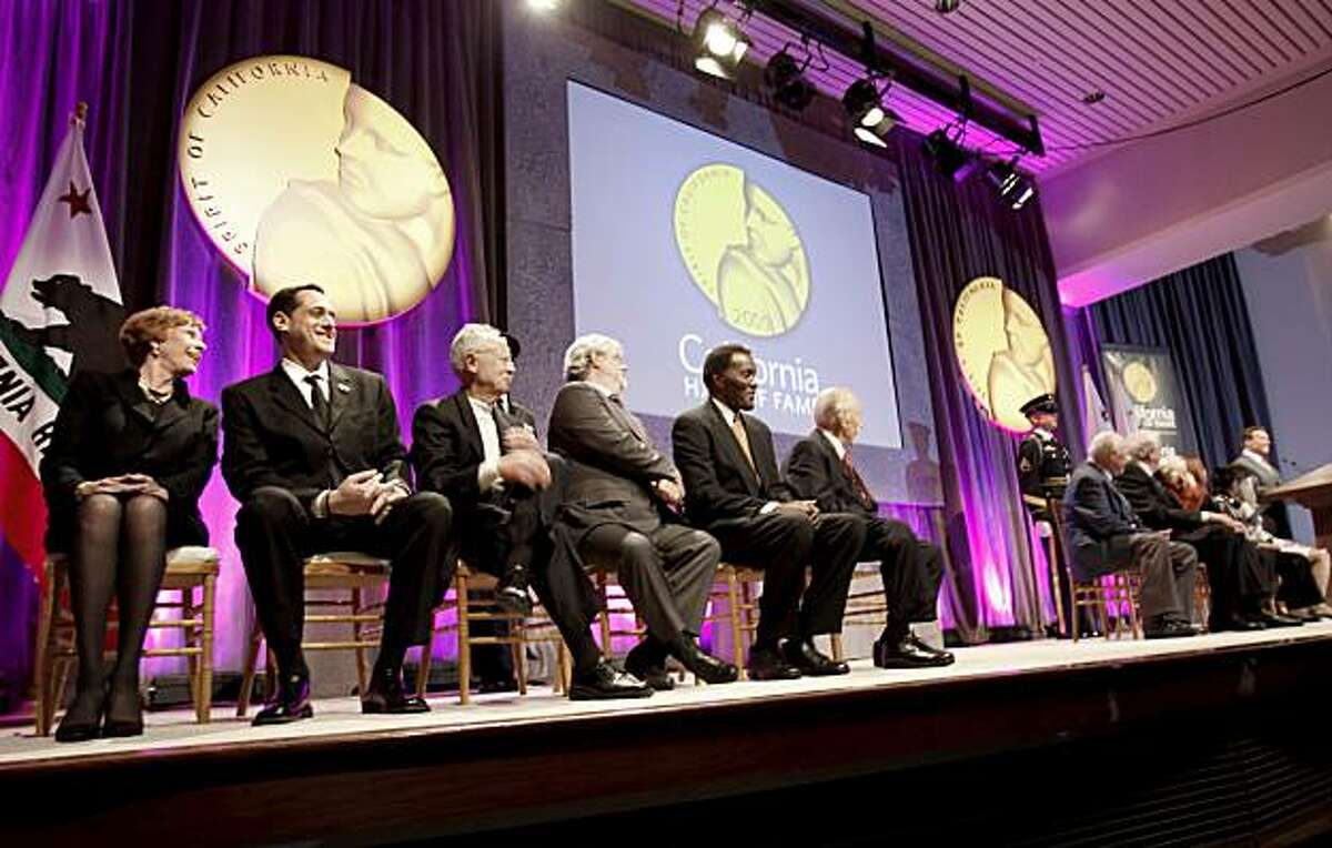 California Hall of Fame inductees laugh at a joke by the governor during the ceremony at the California Museum on Tuesday. At left are Carol Burnett and Stuart Milk, Harvey Milk's nephew.